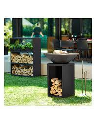 barbacoa ofyr almacen negra jardin 85 Barbacoa redonda Ofyr en acero Corten color negro mate con espacio para la leña.