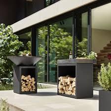 barbacoa ofyr almacen negra terraza 100 Barbacoa redonda Ofyr en acero Corten color negro mate con espacio para la leña.