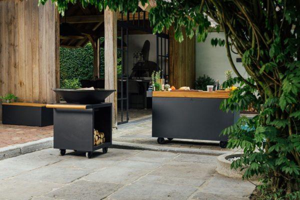 barbacoa ofyr negra pro jardin Barbacoa redonda Ofyr en acero Corten color negro con espacio para la leña y ruedas